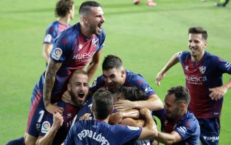HUESCA, SPAIN - JULY 17: Players of SD Huesca celebrate a goal during the La Liga SmartBank match between SD Huesca and Numancia at El Alcoraz on July 17, 2020 in Huesca, Spain. (Photo by Alvaro Calvo /Getty Images)