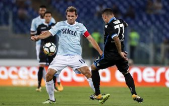 Lazio's Senad Lulic (L) and Spal's Federico Viviani (R) in action during the Italian Serie A soccer match SS Lazio vs Spal 2013 at Olimpico stadium in Rome, Italy, 20 August 2017. ANSA/ANGELO CARCONI
