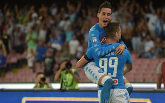 Napoli's Arkadiusz Milik (R) jubilates with his teammate Jose Callejon after scoring the goal during the Italian Serie A soccer match SSC Napoli vs AC Milan at San Paolo stadium in Naples, Italy, 27 August 2016.