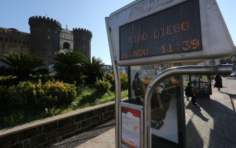 """A bus stop sign opposite the Castel Nuovo reads """"Ciao Diego"""" a day after the death of Argentinian football legend Diego Maradona, on November 26, 2020 in Naples, southern Italy. - Maradona, widely remembered for his """"Hand of God"""" goal against England in the 1986 World Cup quarter-finals, died on November 25, 2020 of a heart attack at his home near Buenos Aires in Argentina, while recovering from surgery to remove a blood clot on his brain. (Photo by Carlo Hermann / AFP) (Photo by CARLO HERMANN/AFP via Getty Images)"""