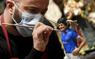 Figurines depicting Diego Armando Maradona (realized by artist Genny Di Virgilio) who will be featured in the traditional Neapolitan Presepio (crib), Naples, 26 November 2020. Diego Maradona has died at the age of 60 after a heart attack on 25 November 2020. ANSA/CIRO FUSCO