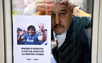 A photo to remember Diego Maradona is exposed by Salvatore Daniele, brother of Neapolitan singer Pino Daniele, on the windows of his house on the ground floor of an alley in the historic center of Naples, Italy, 26 November 2020. Soccer legend Diego Maradona died on 25 November at the age of 60 after a heart attack.ANSA / CIRO FUSCO