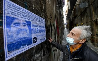a funeral poster for Diego Armando Maradona posted in the alleys of the ancient center of Naples, 26 November 2020. Soccer legend Diego Maradona died on 25 November at the age of 60 after a heart attack.ANSA / CIRO FUSCO
