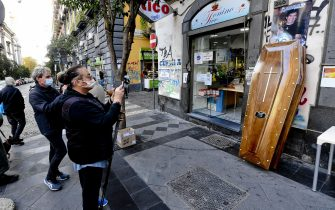 A coffin displayed in front of a bar in the Forcella district in Naples with a plate with the name of Diego Armando Maradona and the dates of birth and death, 26 November 2020. Soccer legend Diego Maradona died on 25 November at the age of 60 after a heart attack. ANSA / CIRO FUSCO