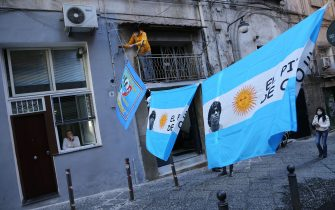 """A view shows flags of Argentina put up in downtown Naples, southern Italy, to mourn the death of Argentinian football legend Diego Maradona, on November 26, 2020. - Maradona, widely remembered for his """"Hand of God"""" goal against England in the 1986 World Cup quarter-finals, died on November 25, 2020 of a heart attack at his home near Buenos Aires in Argentina, while recovering from surgery to remove a blood clot on his brain. (Photo by Carlo Hermann / AFP) (Photo by CARLO HERMANN/AFP via Getty Images)"""