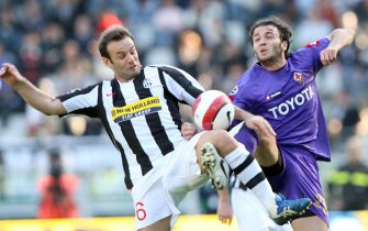 TURIN, ITALY - MARCH 02:  Cristiano Zanetti of Juventus and Giampaolo Pazzini of Fiorentina in action during the Serie A match between Juventus and Fiorentina at the Stadio Olimpico on March 02, 2008 in Turin, Italy. (Photo by New Press/Getty Images)