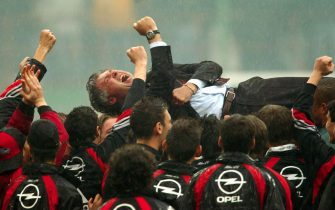 ** FILE ** This photo of AC Milan coach Carlo Ancelotti celebrating with players after winnin the Italian soccer championship in Milan, Italy, Sunday, May 2, 2004, won the sports category of the Chia Sardegna prizes, Italy's most prestigious photojournalism award, in Baia Chia, Sardinia, Italy, Sunday, May 30, 2004. The award was founded 19 years ago to reward the best Italian photo and TV documentary work. (AP Photo/Luca Bruno)