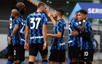 Inter Milan's Lautaro Martinez (R) celebrates with his teammates  after scoring goal of 2  to 1 during the Italian serie A soccer match  between Fc Inter and Crotone at Giuseppe Meazza stadium in Milan 3 January  2021.ANSA / MATTEO BAZZI