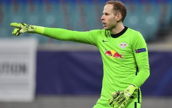 epa08871498 Goalkepeer Peter Gulacsi of Leipzig reacts  during the UEFA Champions League group H soccer match between RB Leipzig and Manchester United in Leipzig, Germany, 08 December 2020.  EPA/Filip Singer