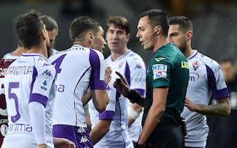 Fiorentina's players talk with referee Di Bello during the italian Serie A soccer match Torino FC vs ACF Fiorentina at the Olimpico Grande Torino Stadium in Turin, Italy, 29 january 2021 ANSA/ALESSANDRO DI MARCO