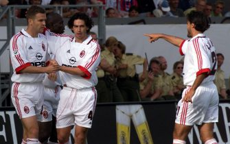 FRA08-19990531-MAINZ, GERMANY: Demetrio Albertini (2ndL) of Italian champion AC Milan congratulates team-mate Oliver Bierhoff (L) who scored the 1-0 led during the friendly match against German champion Bayern Munich in Mainz on Monday 31 May 1999. Looking on is Milan's Federico Giunti (R). Munich lost 2-3.  (ELECTRONIC IMAGE)   EPA PHOTO  DPA/Oliver BERG/obe-fob