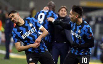 Inter Milan's Lautaro Martinez (R)  jubilates with his teammate Achraf Hakimi after scoring goal of 3 to 1 during the Italian serie A soccer match between FC Inter  and SS Lazio at Giuseppe Meazza stadium in Milan, 14 February  2021.ANSA / MATTEO BAZZI