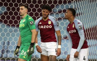 Aston Villa's Tyrone Mings stands dejected with Damian Martinez and Ezri Konsa during the Premier League match at Villa Park, Birmingham. Picture date: Wednesday February 3, 2021.