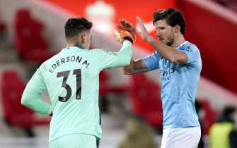 Manchester City goalkeeper Ederson (left) and Ruben Dias celebrate at the end of the Premier League match at Anfield, Liverpool. Picture date: Sunday February 7, 2021.