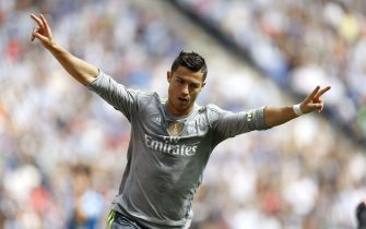 epaselect epa04927046 Real Madrid's Portuguese player Cristiano Ronaldo celebrates his first goal during the Primera Division match against Espanyol held at the Power 8 Stadium in Cornella, Barcelona, Spain, 12 September 2015.  EPA/ALEJANDRO GARCIA