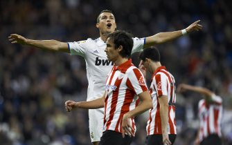 MADRID, SPAIN - NOVEMBER 20:  Cristiano Ronaldo of Real Madrid celebrates after scoring during the la liga match between Real Madrid and Athletic Bilbao at Estadio Santiago Bernabeu on November 20, 2010 in Madrid, Spain. Real Madrid won 5.1.  (Photo by Manuel Queimadelos Alonso/Getty Images)