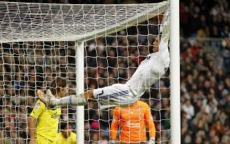MADRID, SPAIN - JANUARY 09:  Cristiano Ronaldo (C) of Real Madrid hangs from the goal during the La Liga match between Real Madrid and Villarreal at Estadio Santiago Bernabeu on January 9, 2011 in Madrid, Spain.  (Photo by Angel Martinez/Real Madrid via Getty Images)