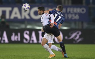 Remo Freuler of Atalanta  challenges Leo Sena of Spezia Calcio during the Serie A match at Gewiss Stadium, Bergamo. Picture date: 12th March 2021. Picture credit should read: Jonathan Moscrop/Sportimage via PA Images