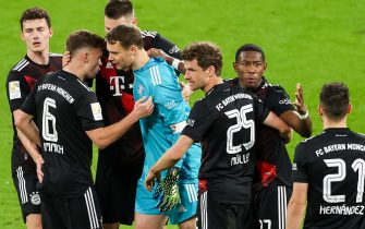 03 April 2021, Saxony, Leipzig: Football: Bundesliga, RB Leipzig - Bayern Munich, Matchday 27 at Red Bull Arena. #Munich players cheer around Munich goalkeeper Manuel Neuer for the win. IMPORTANT NOTE: In accordance with the requirements of the DFL Deutsche Fußball Liga and/or the DFB Deutscher Fußball-Bund, it is prohibited to exploit or have exploited photographs taken in the stadium and/or of the match in the form of sequence pictures and/or video-like photo series. Photo: Alexander Hassenstein/Getty POOL/dpa