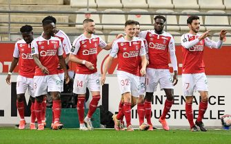 Reims players celebrate after a goal during the French championship Ligue 1 football match between Stade de Reims and Olympique Lyonnais (OL) on March 12, 2021 at Stade Auguste Delaune in Reims, France//04SAIDICHRISTOPHE_0304.15814/2103140905/Credit:CHRISTOPHE SAIDI/SIPA/2103140905