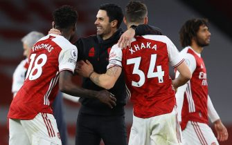 epa09074512 Arsenal's manager Mikel Arteta (C) celebrates with Thomas Partey (L) and Granit Xhaka (R) after the English Premier League soccer match between Arsenal FC and Tottenham Hotspur in London, Britain, 14 March 2021.  EPA/Julian Finney / POOL EDITORIAL USE ONLY. No use with unauthorized audio, video, data, fixture lists, club/league logos or 'live' services. Online in-match use limited to 120 images, no video emulation. No use in betting, games or single club/league/player publications.