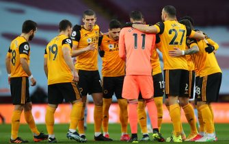 epa09057232 Wolverhampton players gather prior to the English Premier League soccer match between Aston Villa and Wolverhampton Wanderers in Birmingham, Britain, 06 March 2021.  EPA/Catherine Ivill / POOL EDITORIAL USE ONLY. No use with unauthorized audio, video, data, fixture lists, club/league logos or 'live' services. Online in-match use limited to 120 images, no video emulation. No use in betting, games or single club/league/player publications.