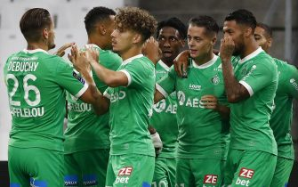 epa08677178 AS Saint Etienne's Romain Hamouna (R) celebrates with teammates after scoring the opening goal during the soccer Ligue 1 match between Olympique Marseille and Saint Etienne at Orange Velodrome stadium, Marseille, France 17 September 2020.  EPA/Guillaume Horcajuelo