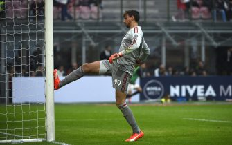 AC Milan's goalkeeper from Italy Gianluigi Donnarumma reacts after a goal during the Italian Serie A football match AC Milan vs Sassuolo on October 25, 2015 at the San Siro Stadium stadium in Milan. AFP PHOTO / OLIVIER MORIN        (Photo credit should read OLIVIER MORIN/AFP/Getty Images)