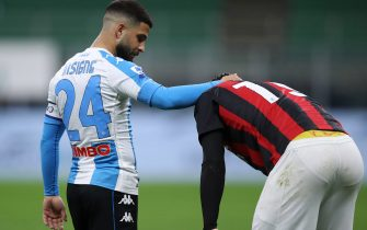 Lorenzo Insigne of SSC Napoli checks on Theo Hernandez of AC Milan after he crashed to the ground following contact with an opponent during the Serie A match at Giuseppe Meazza, Milan. Picture date: 14th March 2021. Picture credit should read: Jonathan Moscrop/Sportimage via PA Images