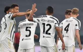 Juventus' Alex Sandro jubilates after scoring the goal (2-1) during the italian Serie A soccer match Juventus FC vs Parma Calcio at the Allianz Stadium in Turin, Italy, 21 April 2021 ANSA/ALESSANDRO DI MARCO