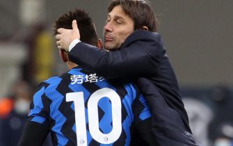 Inter Milan s Lautaro Martinez   jubilates with his coach Antonio Conte after scoring goal of 3 to 1 during the Italian serie A soccer match between FC Inter  and SS Lazio at Giuseppe Meazza stadium in Milan, 14 February  2021.ANSA / MATTEO BAZZI