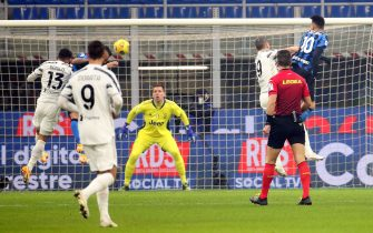 Inter's Arturo Vidal (L) scores goal of 1 to 0 during the Italian serie A soccer match  between FC Inter and Juventus FC at Giuseppe Meazza stadium in Milan 17 January  2021.ANSA / MATTEO BAZZI