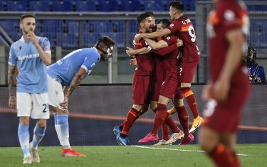 RomaÕs Henrikh Mkhitaryan (C) celebrates his goal with teammates during the Serie A soccer match between AS Roma and SS Lazio at the Olimpico stadium in Rome, Italy, 15 May 2021. ANSA/RICCARDO ANTIMIANI