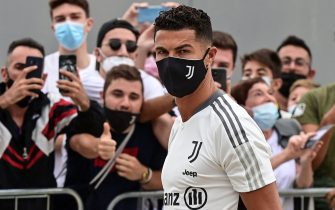 Juventus' Portuguese forward Cristiano Ronaldo is greeted by fans as he arrives for his medical examination at the club's Continassa training ground in Turin, on July 26, 2021. (Photo by MIGUEL MEDINA / AFP) (Photo by MIGUEL MEDINA/AFP via Getty Images)