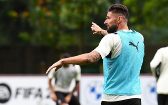CAIRATE, ITALY - JULY 27: Olivier Giroud gestures during an AC Milan Training Session at Milanello on July 27, 2021 in Cairate, Italy. (Photo by Claudio  Villa/AC Milan via Getty Images)