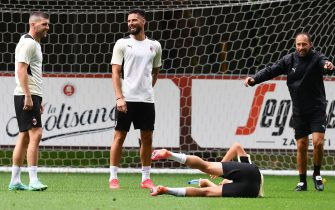 CAIRATE, ITALY - JULY 27: Ante Rebic and Oliver Giroud attend an AC Milan Training Session at Milanello on July 27, 2021 in Cairate, Italy. (Photo by Claudio  Villa/AC Milan via Getty Images)