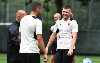 CAIRATE, ITALY - JULY 27: Ante Rebic smiles during an AC Milan Training Session at Milanello on July 27, 2021 in Cairate, Italy. (Photo by Claudio  Villa/AC Milan via Getty Images)