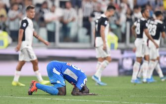 Napoli's Kalidou Koulibaly shows his dejection after his own goal during the Italian Serie A soccer match Juventus FC vs SSC Napoli at the Allianz Stadium in Turin, Italy, 31 August 2019.ANSA/ALESSANDRO DI MARCO
