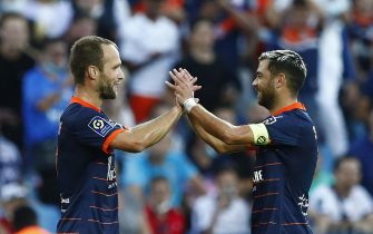 epa09481940 Montpellier HSC's Valere Germain (L) celebrates with teammate Teji Savanier (R) after scoring the opening goal in the French Ligue 1 soccer match between Montpellier HSC and Girondins Bordeaux, Montpellier, France, 22 September 2021.  EPA/Guillaume Horcajuelo