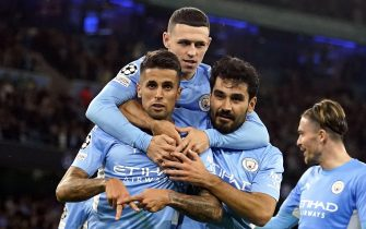 epa09470631 Manchester City's Joao Cancelo (L) celebrates with teammates after scoring the 5-3 lead during the UEFA Champions League group A soccer match between Manchester City and RB Leipzig in Manchester, Britain, 15 September 2021.  EPA/Andrew Yates