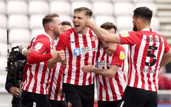 Sunderland's Charlie Wyke celebrates scoring their side's second goal of the game with team-mates during the Sky Bet League One playoff semi final second leg match at the Stadium of Light, Sunderland. Picture date: Saturday May 22, 2021.