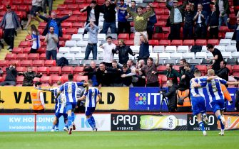 Wigan Athletic players celebrate after team-mate James McClean scores their side's second goal of the game during the Sky Bet League One match at The Valley, London. Picture date: Saturday August 21, 2021.