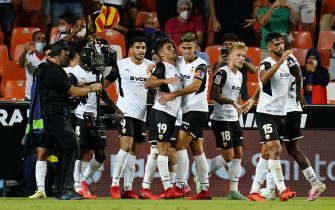 Hugo Duro of Valencia CF celebrates his goal with his teammates during the LaLiga Santander match between Valencia CF and Real Madrid played at Mestalla Stadium on September 19, 2021 in Valencia, Spain. (Photo by PRESSINPHOTO)