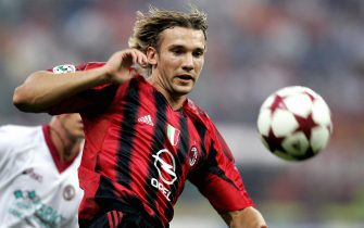 MILAN, ITALY:  AC Milan's forward Andriy Shevchenko of Ukraine runs with the ball during AC Milan vs AS Livorno Serie A football match at San Siro Stadium in Milan, 11 September  2004. The match ended in a 2-2 draw.  AFP Photo/Carlo BARONCINI  (Photo credit should read CARLO BARONCINI/AFP/Getty Images)