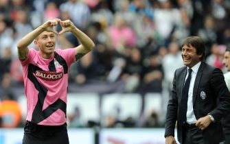 "Italian midfielder of Juventus FC, Luca Marrone (L), jubilates with his coach Antonio Conte after scoring the goal during the Italian Serie A soccer match Juventus FC vs Atalanta BC at the ""Juventus Stadium"" in Turin, Italy, 13 May 2012. ANSA/ALESSANDRO DI MARCO"