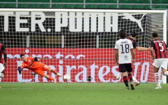 Cagliari s goalkeeper Alessio Cragno saves a penalty kicked by Ac Milan s Zlatan Ibrahimovic (second from R)  during the Italian serie A soccer match  Ac Milan vs Cagliari  at Giuseppe Meazza stadium in Milan 01 August  2020. ANSA / MATTEO BAZZI