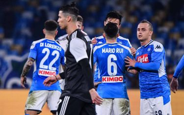 Juventus' Portuguese forward Cristiano Ronaldo (Front L) leaves the pitch as Napoli's Slovakian midfielder Stanislav Lobotka (R) celebrates with teammates at the end of the Italian Serie A football match Napoli vs Juventus on January 26, 2020 at the San Paolo stadium in Naples. (Photo by Alberto PIZZOLI / AFP) (Photo by ALBERTO PIZZOLI/AFP via Getty Images)