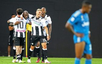 Udinese's Seko Fofana (C) celebrated by his teammates after scoring the goal during the Italian Serie A soccer match Udinese Calcio vs Juventus FC at the Friuli - Dacia Arena stadium in Udine, Italy, 23 July 2020. ANSA/GABRIELE MENIS