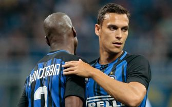 MILAN, ITALY - MAY 28:  Trent Lucas Sainsbury of FC Internazionale Milano (R) celebrates with his teammate Geoffrey Kondogbia during the Serie A match between FC Internazionale and Udinese Calcio at Stadio Giuseppe Meazza on May 28, 2017 in Milan, Italy.  (Photo by Emilio Andreoli/Getty Images)