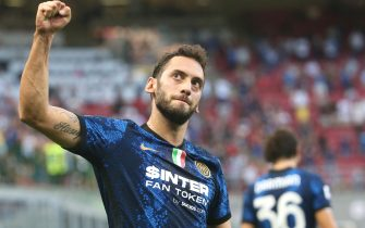 Inter Milan's Hakan Calhanoglu celebrates after scoring  goal of 2 to 0 during the Italian serie A soccer match between FC Inter  and Genoa at Giuseppe Meazza stadium in Milan, 21 August 2021.ANSA / MATTEO BAZZI